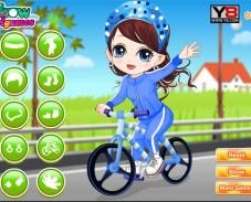 Игра Маленькая девочка учится кататься на велосипеде онлайн